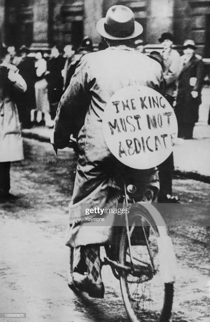 A supporter of King Edward VIII at the time of his abdication wears a placard reading 'The King must not abdicate' December 1936 The King was in...