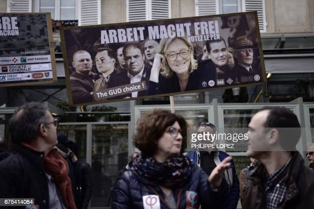 A supporter of 'La France insoumise' holds a placard depicting a composite image featuring French presidential election candidate for the farright...