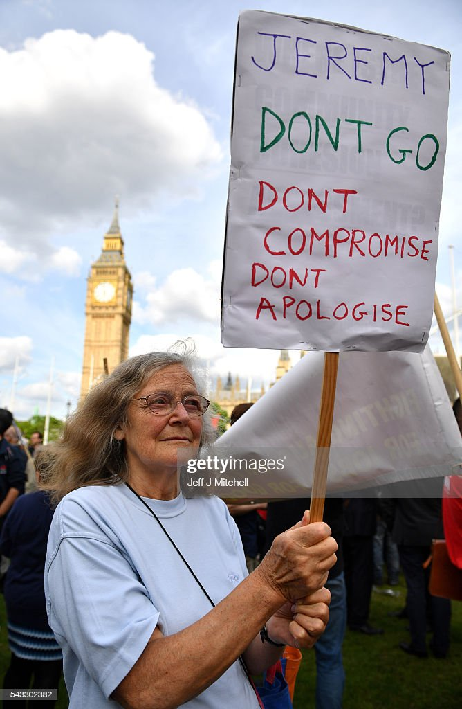 A supporter of Labour leader Jeremy Corbyn holds up a sign during Momentum's 'Keep Corbyn' rally outside the Houses of Parliament on June 27, 2016 in London, England. The Labour Leader has seen mass resignations from the Shadow Cabinet in the wake of the UK Vote for Brexit. His support group, Momentum, have recorded more than 1000 new members in the same period.