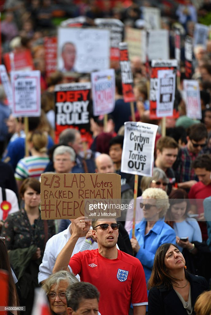 A supporter of Labour leader Jeremy Corbyn holds up a sign saying that 2/3 of Labour voters backed remaining European Union during Momentum's 'Keep Corbyn' rally outside the Houses of Parliament on June 27, 2016 in London, England. The Labour Leader has seen mass resignations from the Shadow Cabinet in the wake of the UK Vote for Brexit. His support group, Momentum, have recorded more than 1000 new members in the same period.