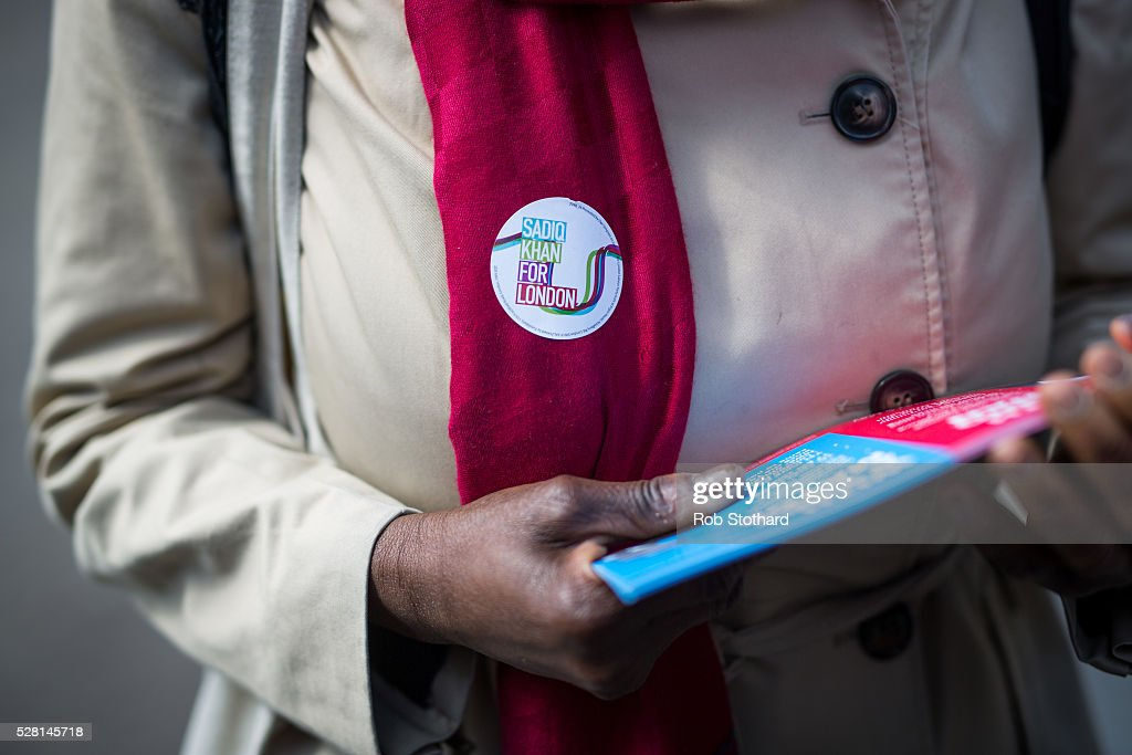A supporter of Labour's London Mayoral candidate Sadiq Khan hands out flyers at East Street Market on May 4, 2016 in London, England. Londoners will go to the polls tomorrow to vote for Mayor Of London with Labour's candidate expected to beat Conservative Party rival Zac Goldsmith to the position.