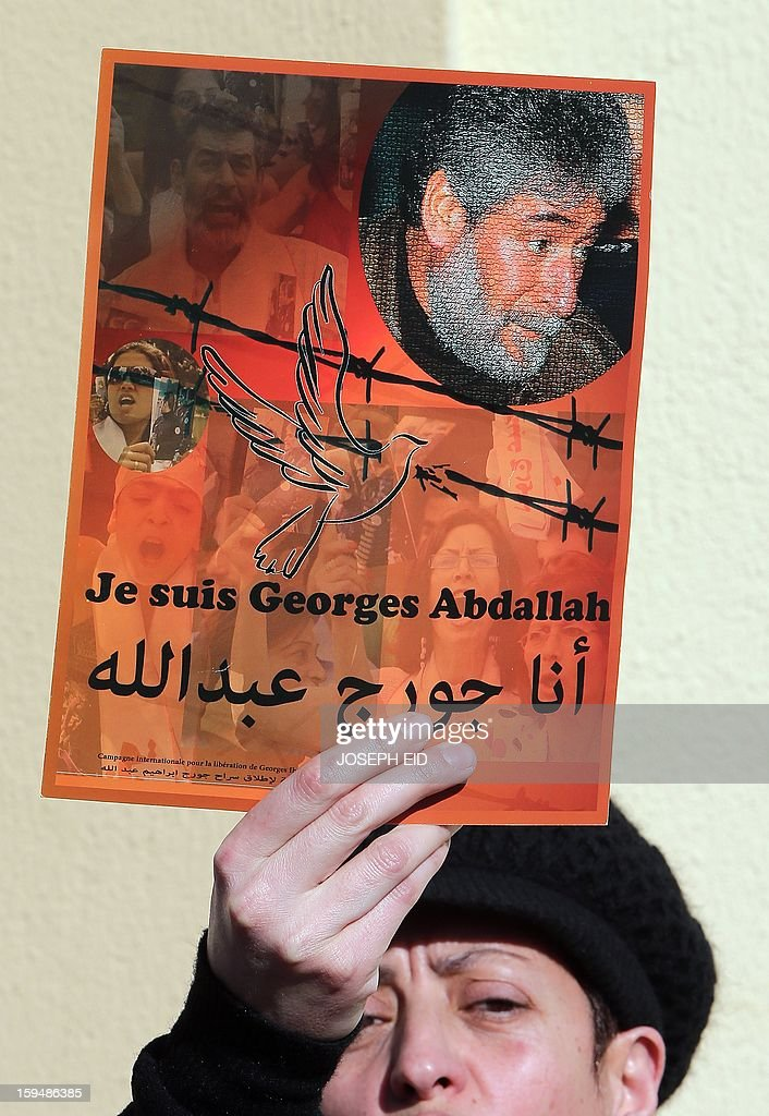 A supporter of Lebanese militant Georges Ibrahim Abdallah shows a placard during a protest outside the French embassy in Beirut against the decision of French interior minister not to sign the documents for his extradition on January 14, 2013. Abdallah, is imprisoned for 28 years in France for complicity in the murder of two diplomats in Paris in 1982.