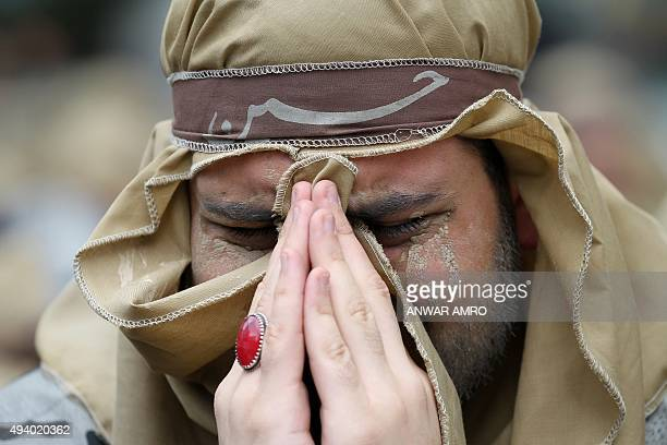 A supporter of Lebanon's Shiite Hezbollah movement attends a rally marking Ashura on the tenth day of the mourning period of Muharram in Beirut's...