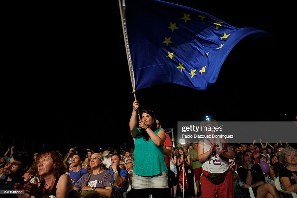 A supporter of left wing alliance party Unidos Podemos 'United We Can' waves a European Union flag during the final rally ahead of Spanish General Elections on June 24, 2016 in Madrid, Spain. Spanish voters head back to the polls on June 26 after the last election in December failed to produce a government. Latest opinion polls suggest the Unidos Podemos 'United We Can' left-wing alliance could make enough gains to come in second behind the caretaker government of the center-right Popular Party.