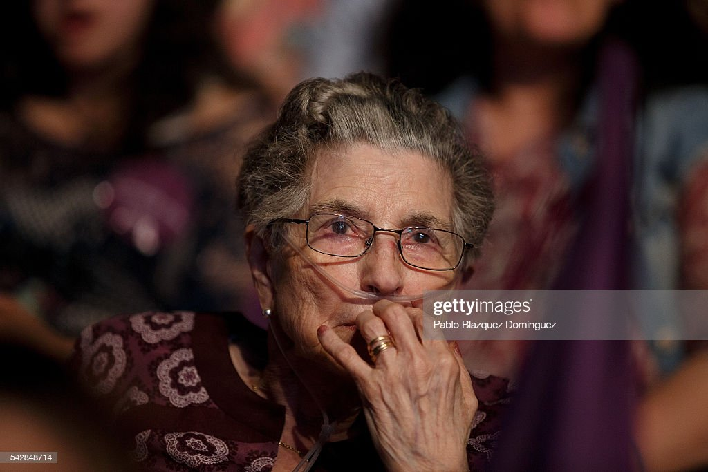A supporter of left wing alliance party Unidos Podemos 'United We Can' uses a breathing machine as she attends the party's final rally ahead of Spanish General Elections on June 24, 2016 in Madrid, Spain. Spanish voters head back to the polls on June 26 after the last election in December failed to produce a government. Latest opinion polls suggest the Unidos Podemos 'United We Can' left-wing alliance could make enough gains to come in second behind the caretaker government of the center-right Popular Party.