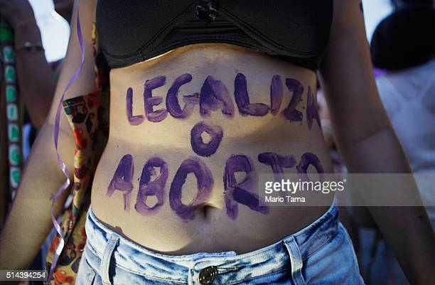 A supporter of legalizing abortion poses during a march for women's rights on International Women's Day on March 8 2016 in Rio de Janeiro Brazil...