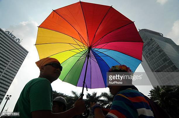 A supporter of lesbian gay bisexual and transgender join a march to mark the International Day Against Homophobia Biphobia and Transphobia in Jakarta...