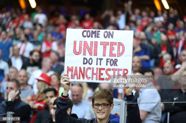 A supporter of Manchester United cheers prior to the UEFA Europa League final football match Ajax Amsterdam v Manchester United on May 24 2017 at the...