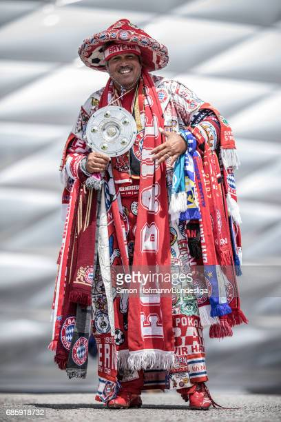 A supporter of Muenchen poses prior to the Bundesliga match between Bayern Muenchen and SC Freiburg at Allianz Arena on May 20 2017 in Munich Germany