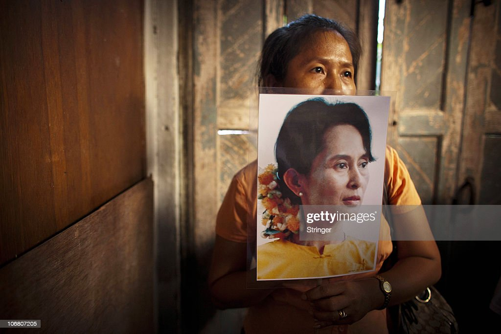 A supporter of Myanmar's detained opposition leader Aung San Suu Kyi holds a portrait of her at the National League for Democracy (NLD) headquarters on November 13, 2010 in Yangon, Burma. Myanmar's democracy leader Aung San Suu Kyi, now aged 65, had been held under house arrest for the majority of the past 15 years but has now finally been released by the country's military leaders. After the first elections in 20 years the military backed Union Solidarity and Development Party (USDP) is reported to have won the election.
