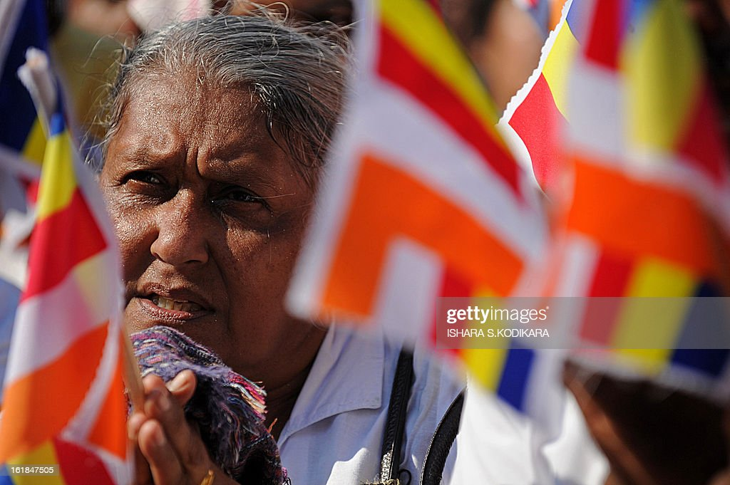 A Supporter of nationalist Buddhist monks prays during a rally calling for a ban on Islamic halal-slaughtered meat at Maharagama, a suburb of the capital Colombo, February 17, 2013. A new group known as the Bodu Bala Sena, or Buddhist Force, launched a drive to press for a boycott of all halal products in a country where the majority are Buddhists. AFP PHOTO/Ishara S
