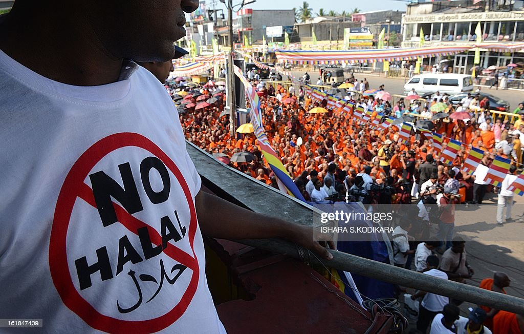 A supporter of nationalist Buddhist monks wears a T-shirt calling for a ban on Islamic halal-slaughtered meat, during a rally at Maharagama, a suburb of the capital Colombo, February 17, 2013. A new group known as the Bodu Bala Sena, or Buddhist Force, launched a drive to press for a boycott of all halal products in a country where the majority are Buddhists. AFP PHOTO/Ishara S