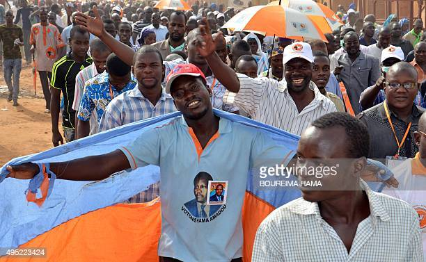 A supporter of Niger's opposition party wears a shirt with an image of the Patriotic and Republican Front leader and former Prime Minister Hama...