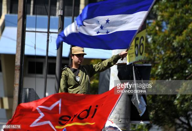 A supporter of opposition candidate Salvador Nasralla takes part in a protest in Tegucigalpa on December 10 2017 The protests that have been ongoing...