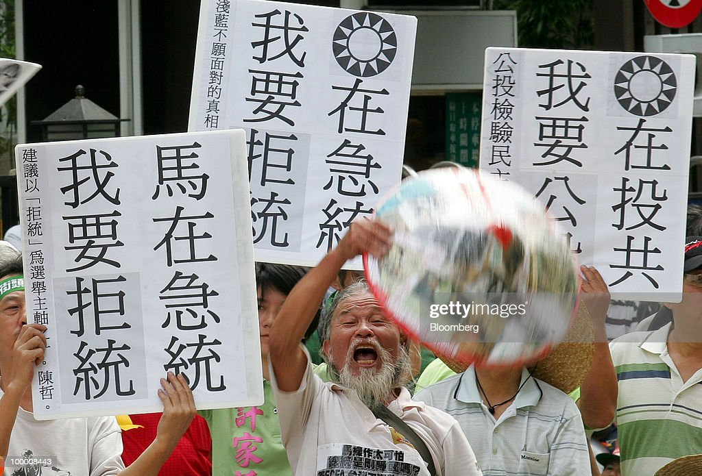 A supporter of opposition Democratic Progressive Party (DPP) shouts at a sit-in protest in Taipei, Taiwan, on Thursday, May 20, 2010. President Ma Ying-jeou has pushed for the trade agreement with China to prevent Taiwan from being 'marginalized' after a Chinese accord with the 10-member Association of Southeast Asian Nations took effect this year. The proposal sparked opposition demonstrations amid concern China may boost its influence over Taiwan. Photographer: Maurice Tsai/Bloomberg via Getty Images
