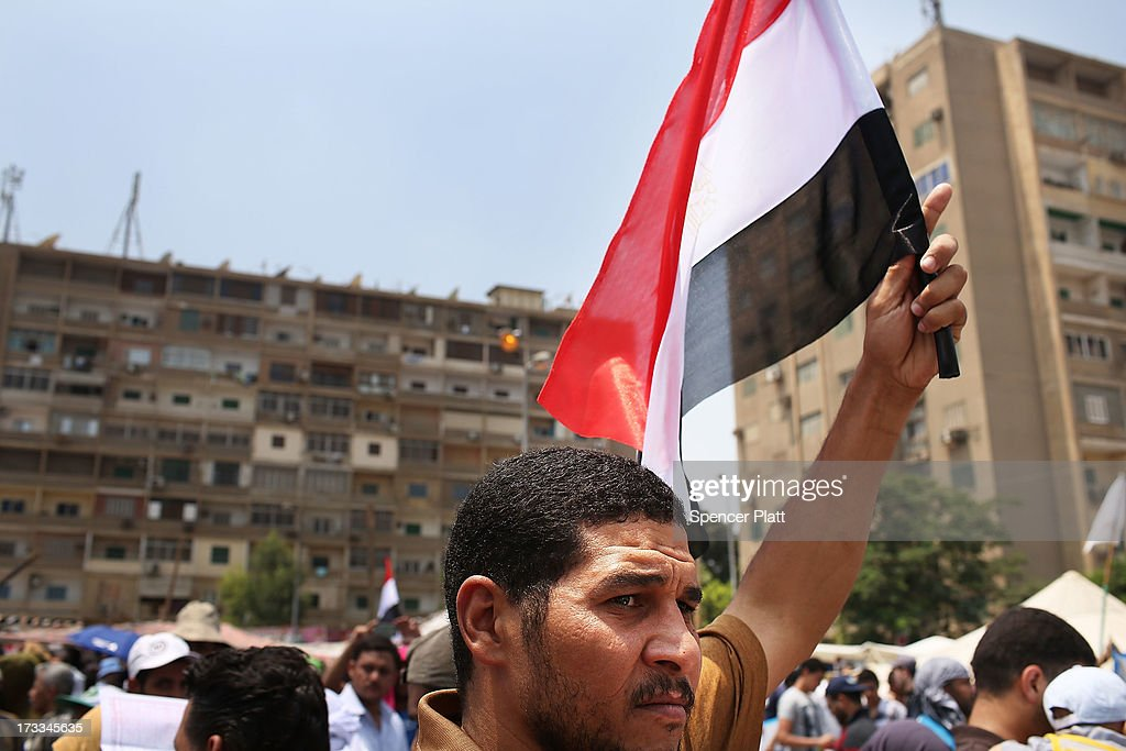 A supporter of ousted president Mohamed Morsi carries an Egyptian flag following the Friday prayer on the third day of Ramadan, the sacred holy month for Muslims where many will fast from sun-up to sun-down on July 12, 2013 in Cairo, Egypt. Egypt continues to be in a state of political paralysis following the ousting of former President and Muslim Brotherhood leader Mohamed Morsi by the military. Adly Mansour, chief justice of the Supreme Constitutional Court, was sworn in as the interim head of state in a ceremony in Cairo on the morning of July 4.