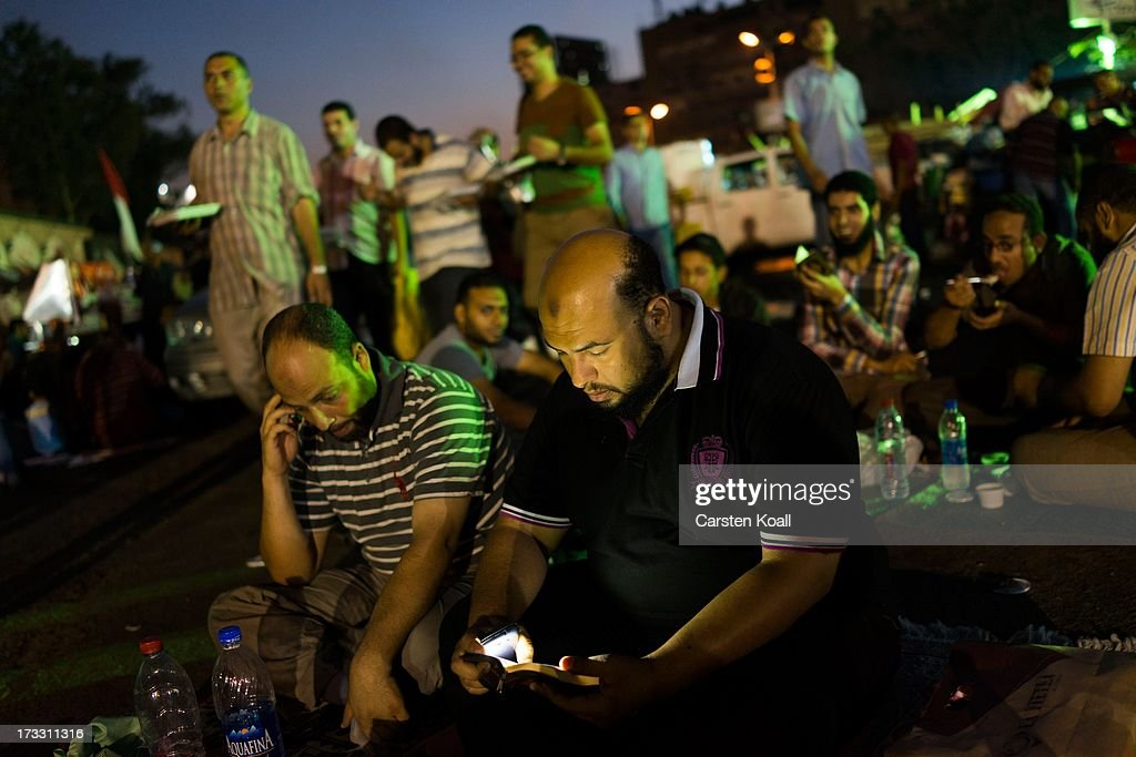 A supporter of ousted president Mohamed Morsi reads the Koran after breaking the daily Ramadan fast on the second day of Ramadan the sacred holy...