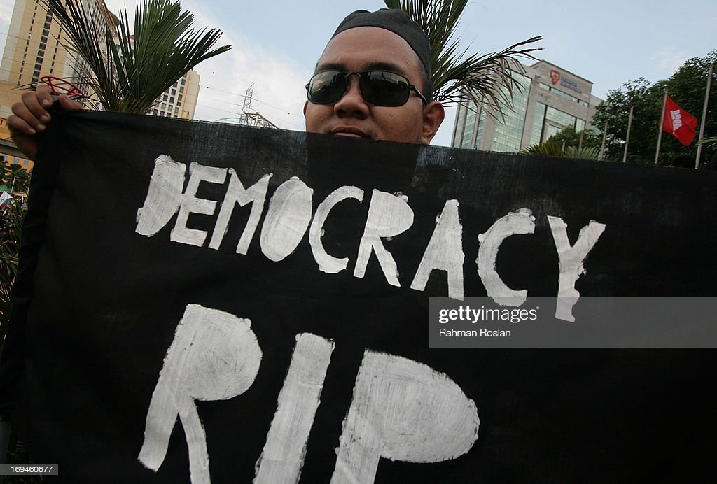 A supporter of Pakatan Rakyat gholds up a banner during a political rally against election fraud on May 25, 2013 in Kuala Lumpur, Malaysia. Thousands of supporters of Pakatan Rakyat (People's Pact/People's Alliance) gathered to voice their dissatisfaction over alleged election fraud in Malaysia's 13th General election result.