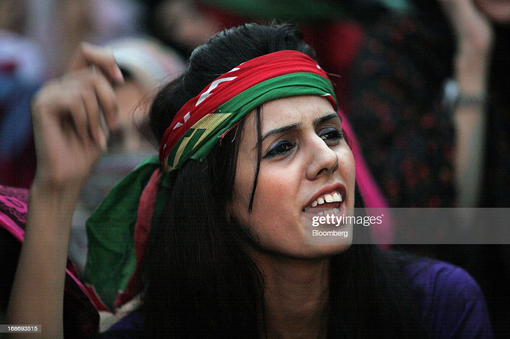 A supporter of Pakistan's Tehreek-e-Insaf (PTI) chairman Imran Khan shouts slogans against during a demonstration in Karachi, Pakistan, on Monday, May 13, 2013. Nawaz Sharif was headed for a record third term as prime minister of Pakistan as unofficial results from a landmark election gave him the convincing win he sought to tackle a slumping economy and growing militancy. Photographer: Asim Hafeez/Bloomberg via Getty Images