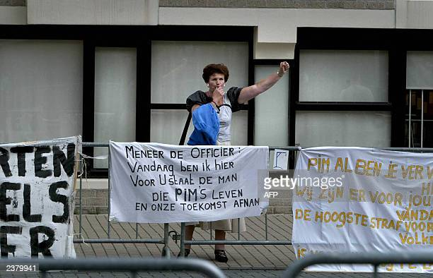 A supporter of Pim Fortuyn demonstrates 18 July 2003 in front of the Amsterdam court house A Dutch appeal court confirmed an 18year sentence for the...