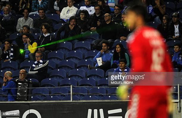 A supporter of Porto points a green laser light at Nacional's goalkeeper Rui Silva during the Portuguese league football match FC Porto vs Nacional...