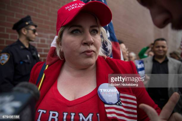 A supporter of President Donald Trump Diane Atkins from Brooklyn New York speaks with media before the arrival of the motorcade carrying President...
