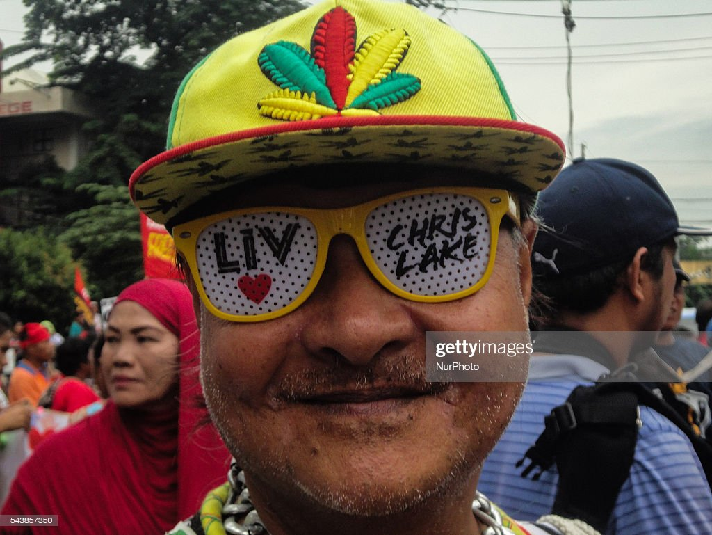 A supporter of President Rodrigo Duterte attends a rally held on Philippine President Rodrigo Duterte's inauguration on Thursday, 30 June 2016, in Manila, Philippines.