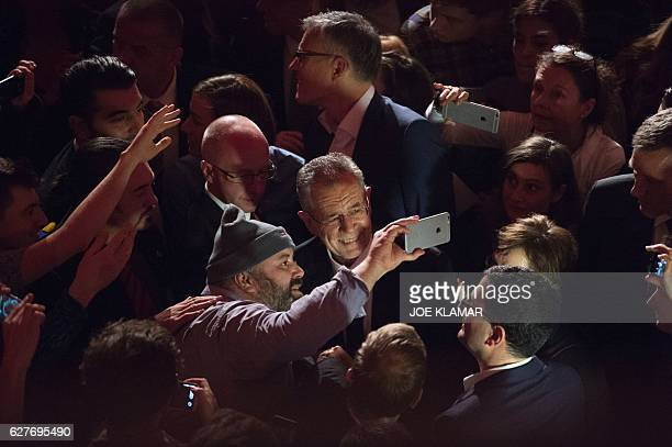 TOPSHOT A supporter of Presidential candidate Alexander Van der Bellen takes a selfie with him during his postelection party in Vienna in Vienna on...