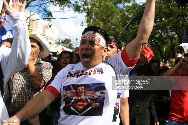 A supporter of presidential candidate for Honduras' Opposition Alliance against Dictatorship Salvador Nasralla demonstrates in front of the United...