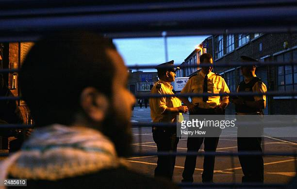 A supporter of radical Islamic group Al Muhajiroun waits outside a closed gate after police close a planned meeting September 11 2003 in London Al...