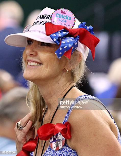A supporter of Republican presidential candidate Donald Trump attends a campaign rally at Silver Spurs Arena inside the Osceola Heritage Park in...
