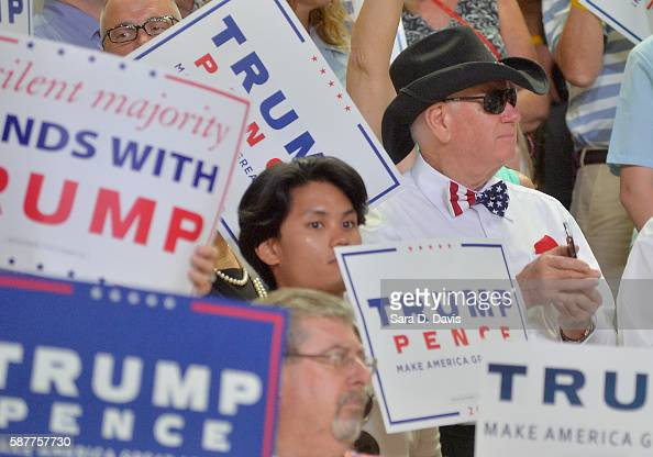 A supporter of Republican presidential candidate Donald Trump awaits his arrival for a campaign event at Trask Coliseum on August 9 2016 in...