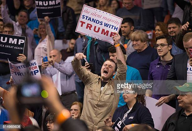 A supporter of Republican presidential candidate Donald Trump heckles demonstrators before the start of a rally at the University of Illinois at...