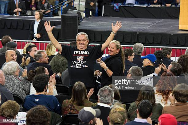 A supporter of Republican presidential candidate Donald Trump wearing a Trump and Tom Brady T shirt during a campaign rally at the University of...