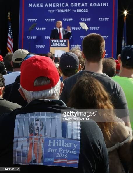 ... Donald Trump wears a shirt that reads 'Hillary for Prison' as Trump
