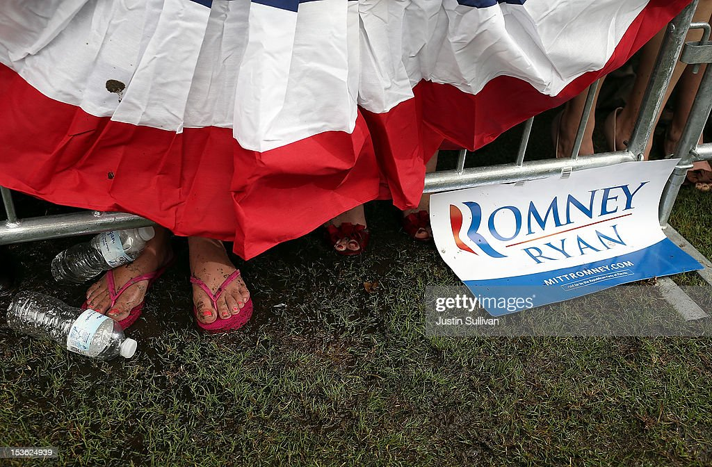 A supporter of Republican presidential candidate, former Massachusetts Gov. Mitt Romney stands in mud during a victory rally at Tradition Town Square on October 7, 2012 in Port St. Lucie, Florida. Mitt Romney is campaigning in Florida before traveling to Virginia where he is scheduled to give a foreign policy speech at the Virginia Military Institute.