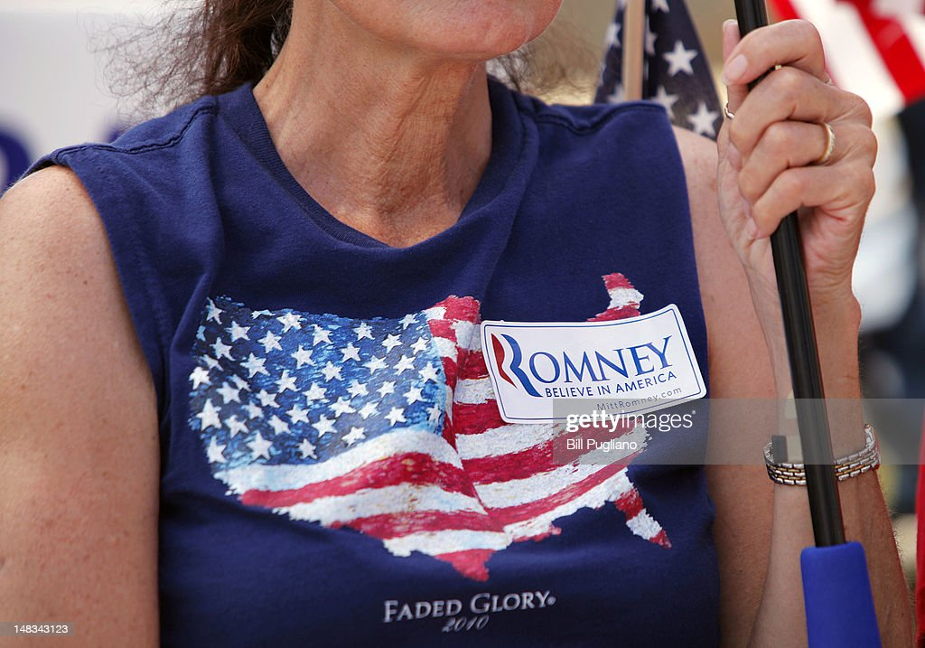 A supporter of Republican presidential candidate Mitt Romney waits for Sarah Palin, former Governor of Alaska and 2008 Republican vice presidential candidate, to speak at the 'Patriots in the Park' Tea Party rally at the Wayne County Fairgrounds July 14, 2012 in Belleville, Michigan. The event was sponsored by Americans for Prosperity: Michigan and the Willow Run Tea Party Caucus.
