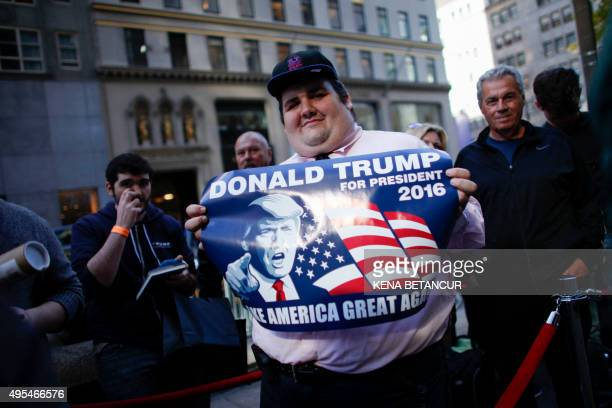 A supporter of Republican presidential hopeful Donald Trump waits in line the launch event for Trump's new book 'Crippled America How to Make America...