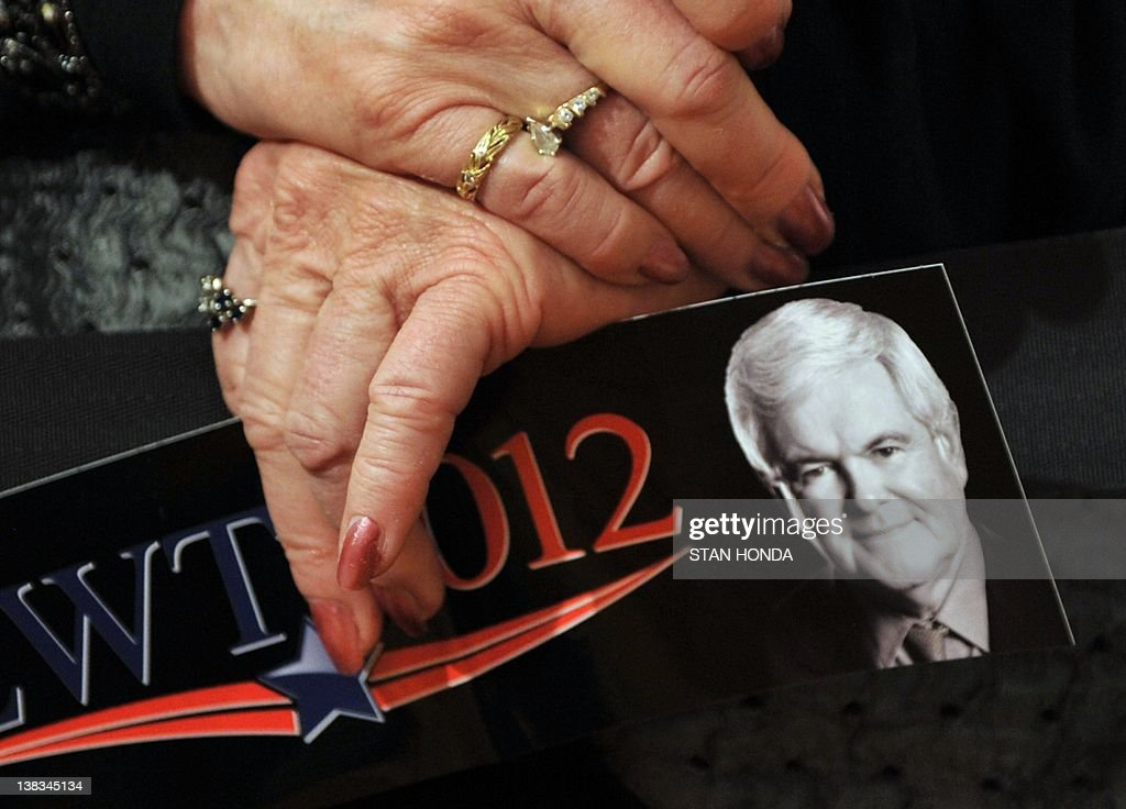 A supporter of Republican presidential hopeful Newt Gingrich holds a bumper sticker at a rally February 6, 2012 in Golden, Colorado, on the eve of the state caucus. Republican presidential hopeful Newt Gingrich looked to a 'Super Tuesday' vote bonanza in March to rescue his faltering campaign after a second consecutive thumping from rival Mitt Romney in Nevada. Colorado, Minnesota and Missouri vote on February 7th, before Arizona and Michigan on February 28, and then the state of Washington on March 3. AFP PHOTO/Stan HONDA