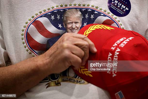 A supporter of Republican presidential nominee Donald Trump recites the pledge of allegiance during a campaign rally at the Sioux City Convention...