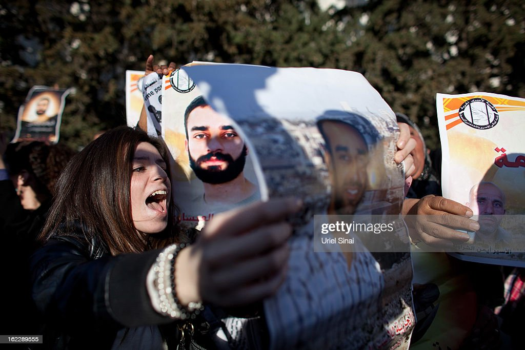 A supporter of Samer al-Issawi, a Palestinian prisoner on a hunger strike, demonstrates outside the Magistrate's Court on February 21, 2013 in Jerusalem, Israel. Issawi, one of the prisoners who was released under terms of the 2011 Gilad Shalit prisoner swap, was rearrested last July on charges of violating the terms of his release when he took his car to a garage in the West Bank.