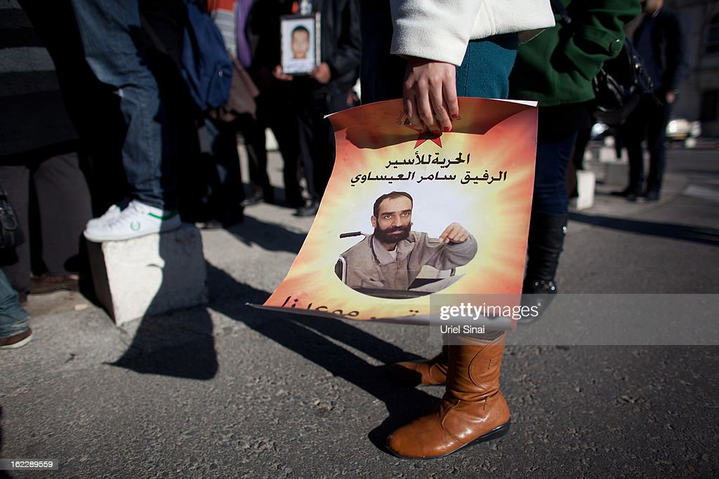 A supporter of Samer al-Issawi, a Palestinian prisoner on a hunger strike, holds a poster during a demonstration outside the Magistrate's Court on February 21, 2013 in Jerusalem, Israel. Issawi, one of the prisoners who was released under terms of the 2011 Gilad Shalit prisoner swap, was rearrested last July on charges of violating the terms of his release when he took his car to a garage in the West Bank.
