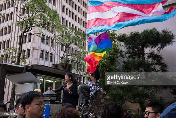 A supporter of samesex marriage holds a flag during the protest outside The Legislative Yuan of Republic of China on November 17 2016 in Taipei...