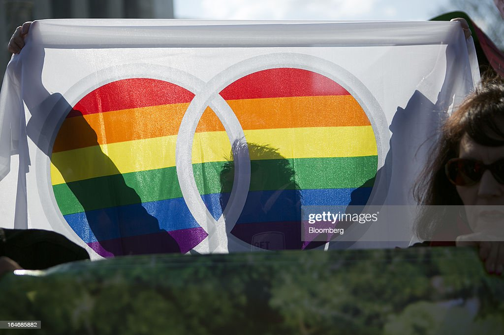 A supporter of same-sex marriage holds a rainbow flag outside the U.S. Supreme Court in Washington, D.C., U.S., on Tuesday, March 26, 2013. The Supreme Court takes up what is probably its biggest civil-rights dispute in decades this week when it hears arguments that could lead to the legalization of same-sex marriage nationwide. Photographer: Andrew Harrer/Bloomberg via Getty Images
