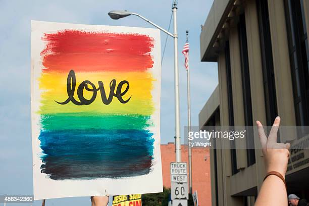 A supporter of samesex marriage holds a sign during a protest in front of the federal courthouse September 3 2015 in Ashland Kentucky Kim Davis the...