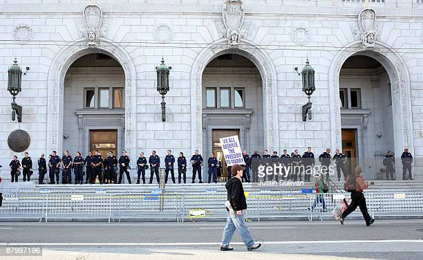 A supporter of samesex marriage walks by the California Supreme Court following its ruling to uphold Proposition 8 May 26 2009 in San Francisco...