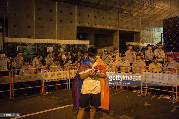 A supporter of samesex marriage wears a flag during the protest outside The Legislative Yuan of Republic of China on November 17 2016 in Taipei...