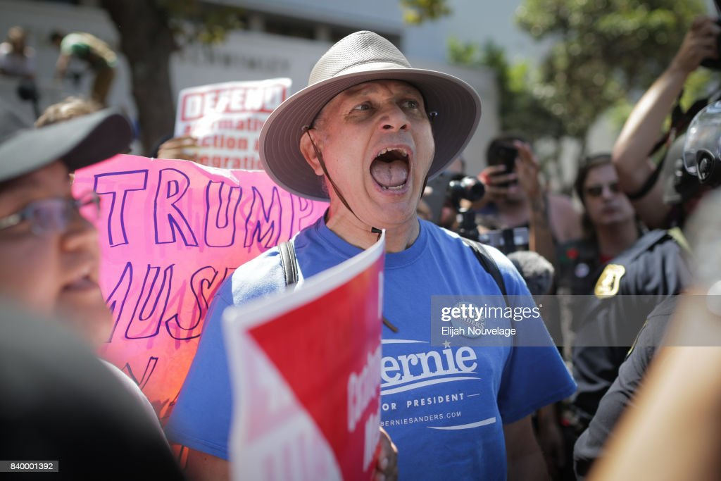 A supporter of Sen. Bernie Sanders yells at a Trump supporter at MLK Jr. Park on August 27, 2017 in Berkeley, California. Hundreds of people opposed to President Trump and hundreds more aligned with Antifa descended on the park after a planned right-wing rally was cancelled.