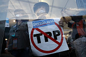 A supporter of Senator Bernie Sanders an independent from Vermont holds a sign against the TransPacific Partnership while demonstrating inside the...