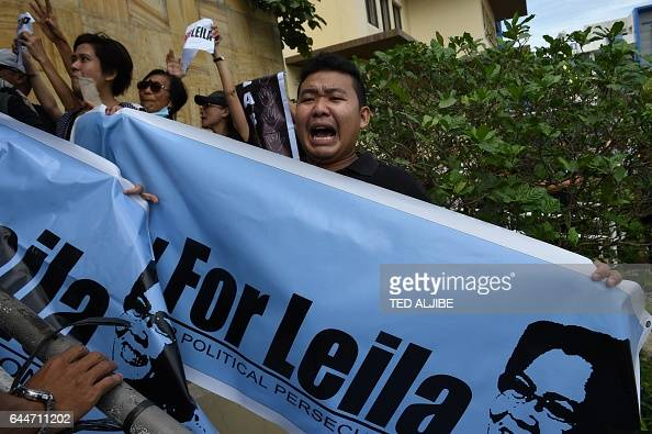 A supporter of Senator Leila De Lima a top critic of President Rodrigo Duterte shouts slogans as they hold a rally outside the court building in...